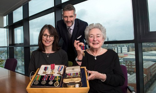 Former accountant and World War II hero has medals presented to niece after decades in firm's safe